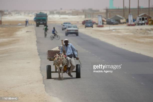 A man rides a donkeycart in Nouakchott Mauritania on August 13 2019 Although the capital Nouakchott develops day by day there is still no water...