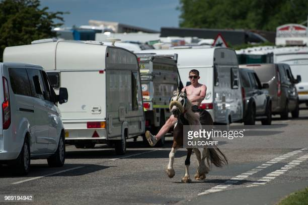 A man rides a horse along Long Marton Road on the opening day of the annual Appleby Horse Fair in the town of ApplebyinWestmorland northwest England...