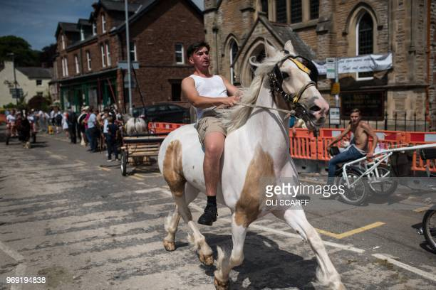 A man rides a horse along The Sands street on the opening day of the annual Appleby Horse Fair in the town of ApplebyinWestmorland northwest England...