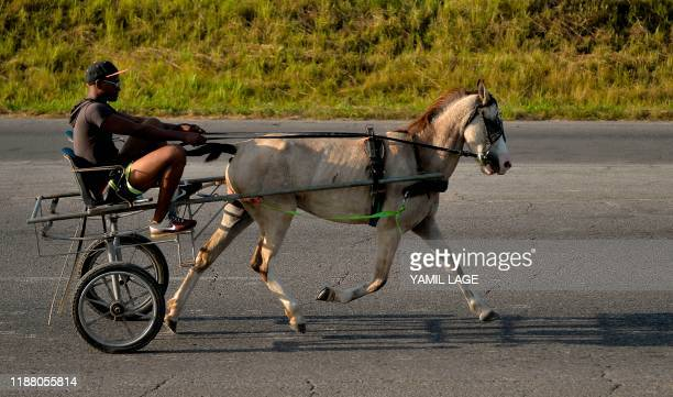 A man rides a horse carriage in Vinales Pinar del Rio province on November 24 2019 Due to a lack of fuel Cuba resorts to animal traction to boost its...