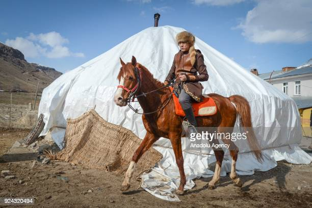 A man rides a horse near a pavilion put up by Kyrgyz brothers Kenan and Ahmet Aytac emigrated from Afghanistan's Pamir plateau 36 years ago and...