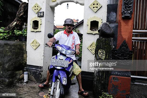 A man rides a motorcycle out of a house where Australian drug trafficker Schapelle Corby's sister and brother in law Mercedes Corby and Wayan...