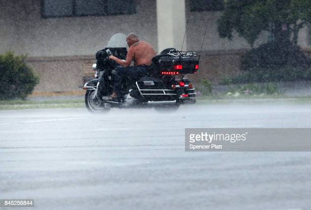 A man rides a motorcycle through the wind and rain as Hurricane Irma arrives into southwest Florida on September 10 2017 in Bonita Springs Florida...