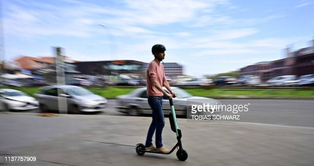 A man rides an EScooter of rental company Tier in Berlin on April 17 2019 German ministers agreed rules for using batterypowered scooters on the...