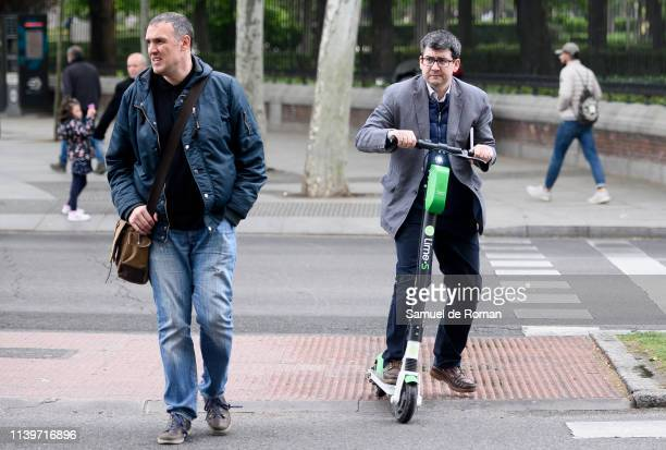 A man rides an escooter on April 01 2019 in Madrid Spain Several companies offer their electric scooters in the city as an alternative of more...