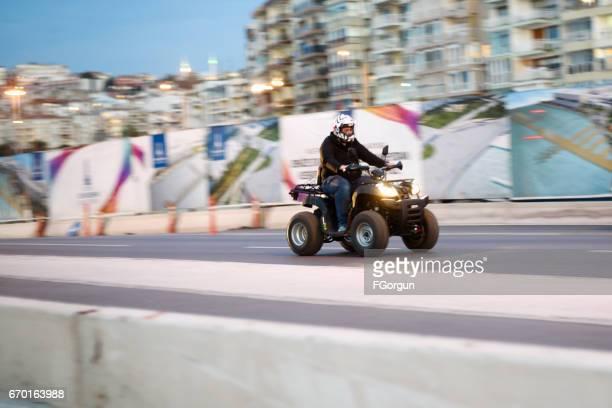 Man rides Atv