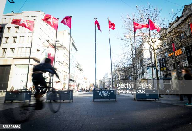 A man rides his bicycle at SintMichielskaai in Antwerp on March 23 after Belgian security forces arrested a French national after he tried to drive...