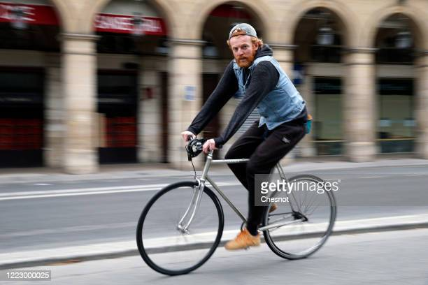 A man rides his bicycle in the deserted and carfree rue de Rivoli as the lockdown continues due to the epidemic of coronavirus on May 05 2020 in...