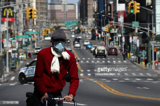 Man rides his bicycle on a virtually empty Canal St on Easter Sunday on April 12, 2020 in New York City.