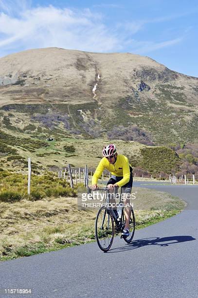 A man rides his bicycle on April 20 2011 on the road toward the Col de la Croix Saint Robert one of the stages of the 2011 Tour de France cycling...