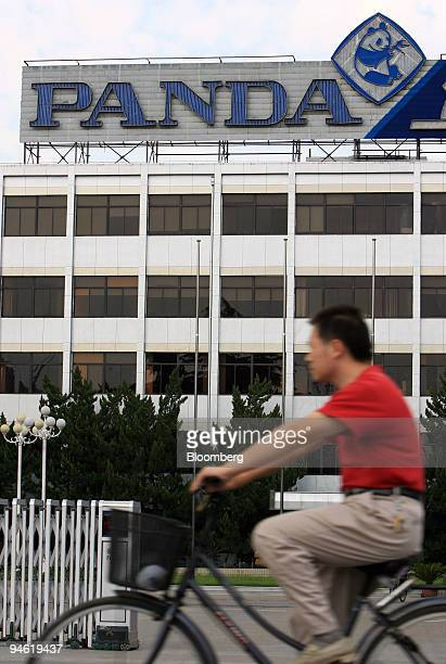 A man rides his bicycle past Nanjing Panda Electronics Co Ltd headquarters in Nanjing Jiangsu province China Sunday August 20 2006 Nanjing Panda...