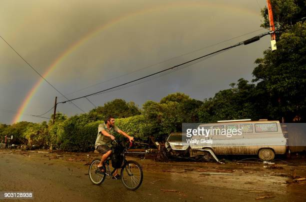 A man rides his bike along Olive Mill Road in Montecito after a major storm hit the burn area Tuesday January 9 2018 in Montecito California