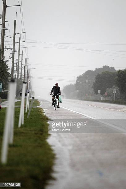A man rides his bike along Overseas Highway as Tropical Storm Isaac begins to move toward the Florida Keys on August 26 2012 in Islamorada Florida...