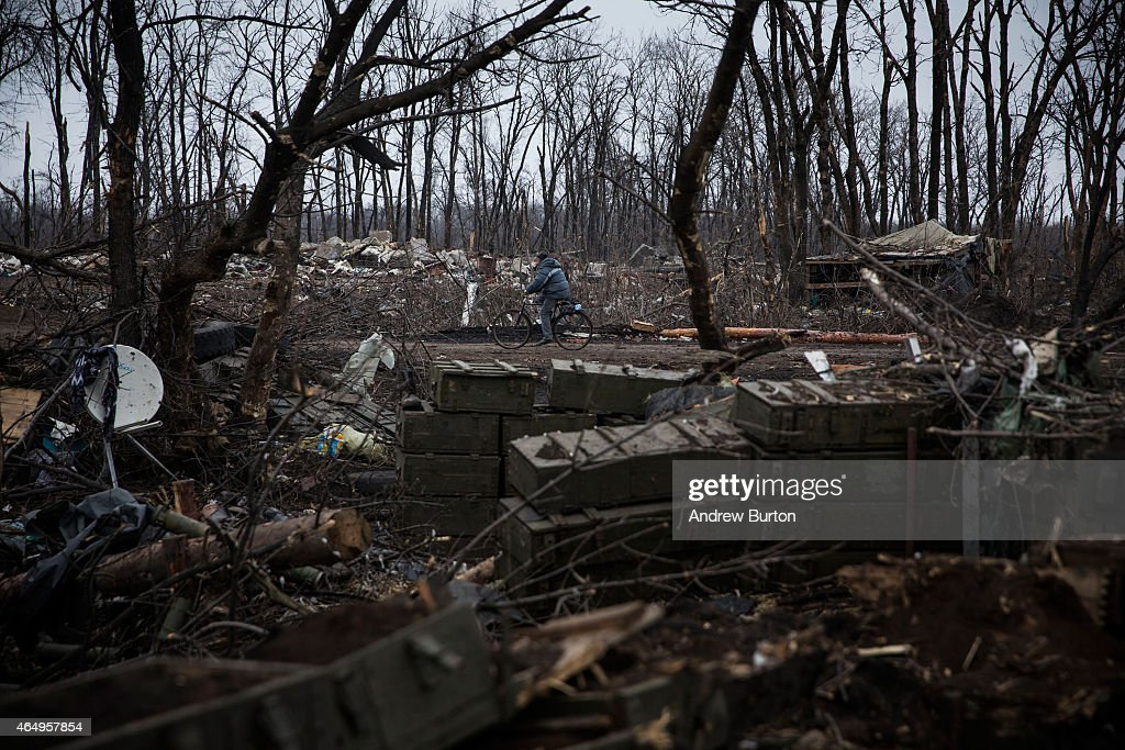 A man rides his bike through a desimated battlefield where the Ukrainian army was defeated by pro-Russian rebels on March 2, 2015 on the outskirts of Debaltseve, Ukraine. In a new report the United Nations announced over 6,000 people have been killed since the armed conflict started last April.