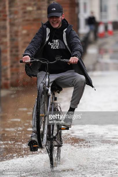 A man rides his bike through floodwater as water levels in the River Ouse in York begin to recede on February 17 2020 in York England Storm Dennis is...