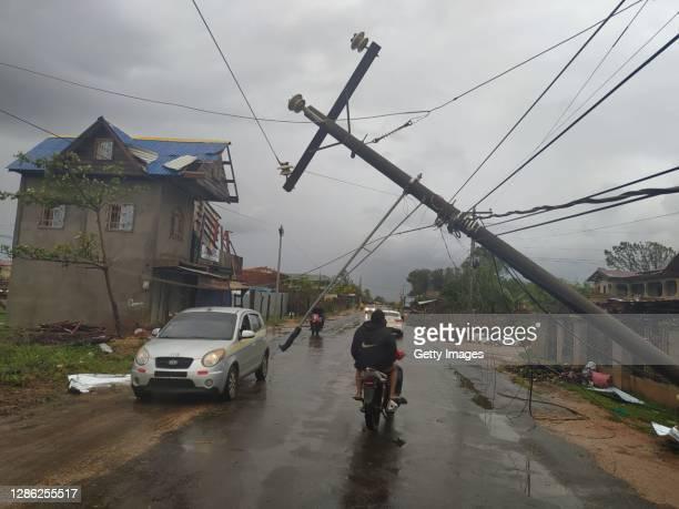 Man rides his motorbike trough a road damaged by heavy winds of Hurricane Iota at Barrio El Aeropuerto on November 17, 2020 in Puerto Cabezas,...
