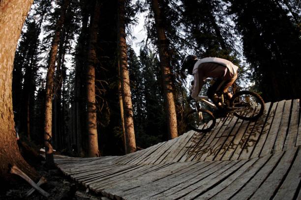 A man rides his mountain bike on a boardwalk on Teton Pass, Wyoming.
