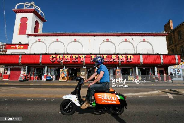 A man rides his scooter along the sea front as owners and enthusiasts from all around the country take part in the first day of the Easter National...
