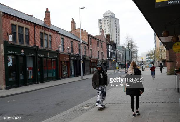 Man rides his skateboard in the redevelopment Hales Street area of the city as it prepares for the UK City of Culture events on April 14, 2021 in...