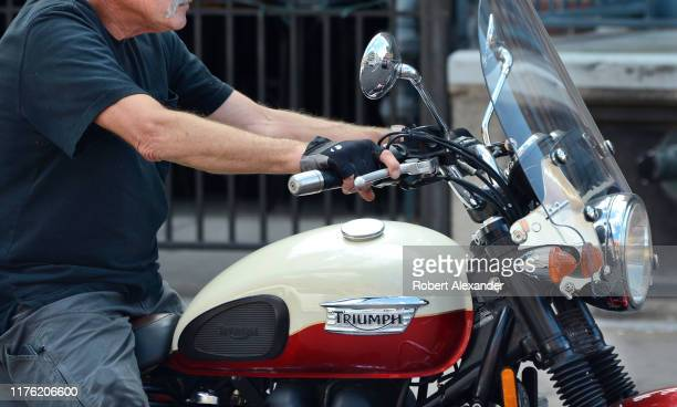 Man rides his Triumph motorcycle in Nashville, Tennessee.