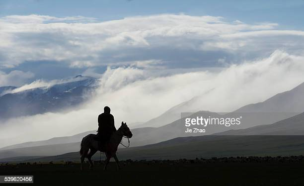 A man rides on a horse in Bayanbulak Grasslands in Xinjiang Uyghur Autonomous Region northhwest China on 6th June 2015