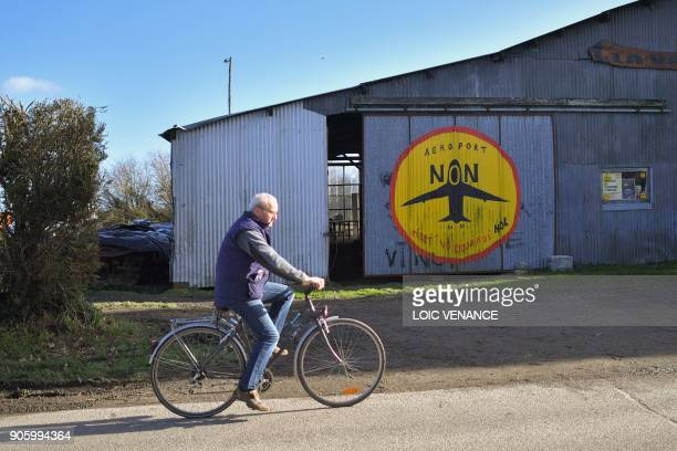 A man rides past La Vache rit a farm in the 'Zad' of NotreDamedesLandes after French prime minister announced the French government's official...