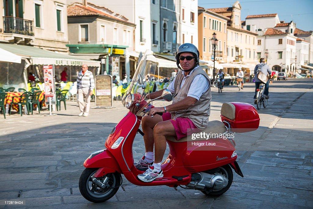 man rides red vespa on corso del popolo ストックフォト getty images