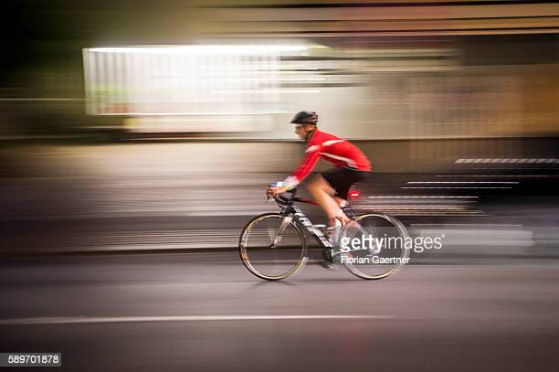A man rides with his bicycle at night on August 09 2016 in Berlin Germany