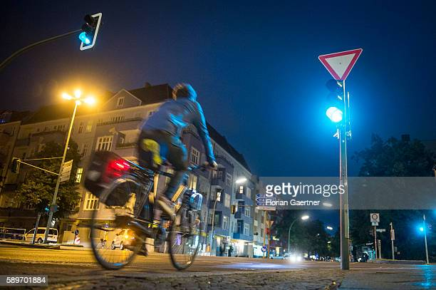 A man rides with his bike over a crossroad during green traffic light on August 09 2016 in Berlin Germany