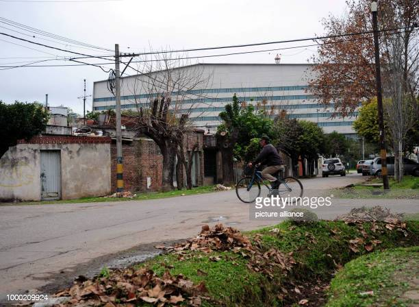 A man riding a bicycle in front of the 'City Center' building complex in Rosario Argentina 28 June 2017 where soccer star Lionel Messi and his...