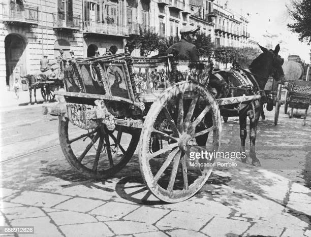 Man riding a decorated Sicilian cart Sicily 1950s