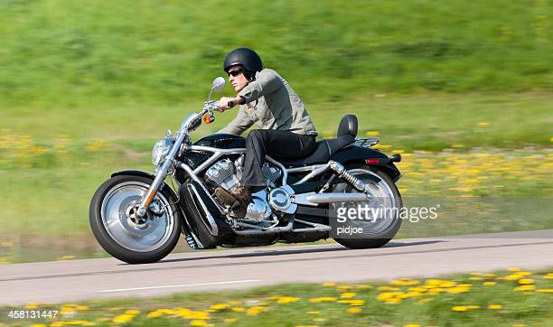 man riding a harley davidson - harley davidson stock pictures, royalty-free photos & images