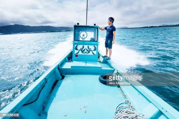 A man riding a motor boat