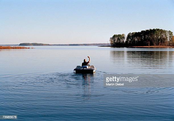 Man riding a pedal boat on a lake