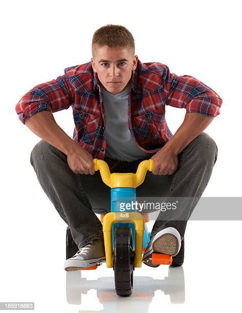 man riding a tricycle - tricycle stock pictures, royalty-free photos & images