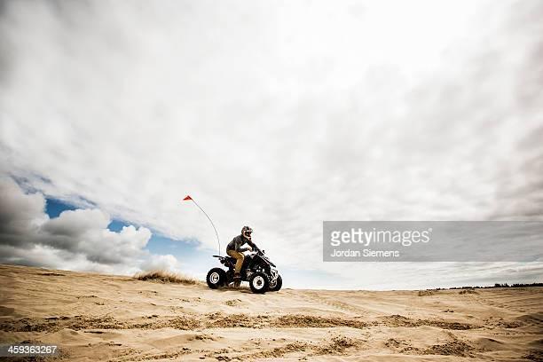 man riding all-terrain vehicle. - のりものに乗る ストックフォトと画像
