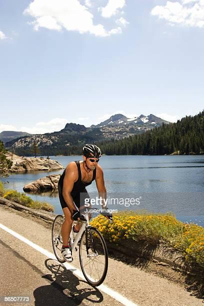 Man riding bicycle at Lake Tahoe, California, United States