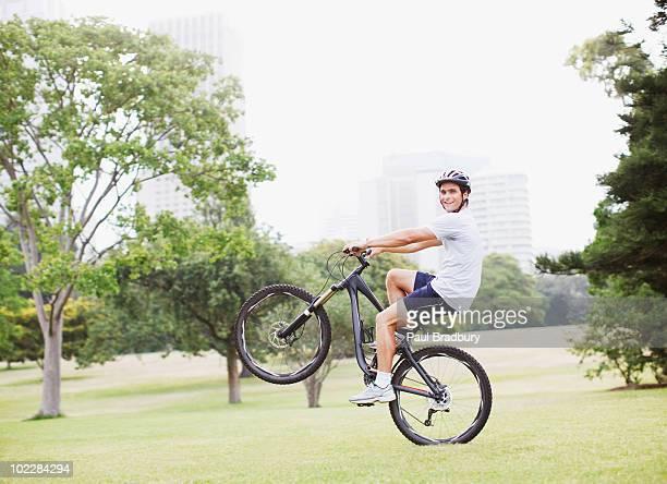 Man riding bicycle in urban park