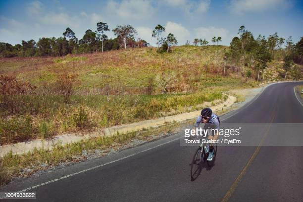 man riding bicycle on road - torwai stock pictures, royalty-free photos & images