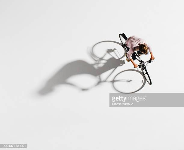 man riding bicycle on white background, overhead view - draufsicht stock-fotos und bilder