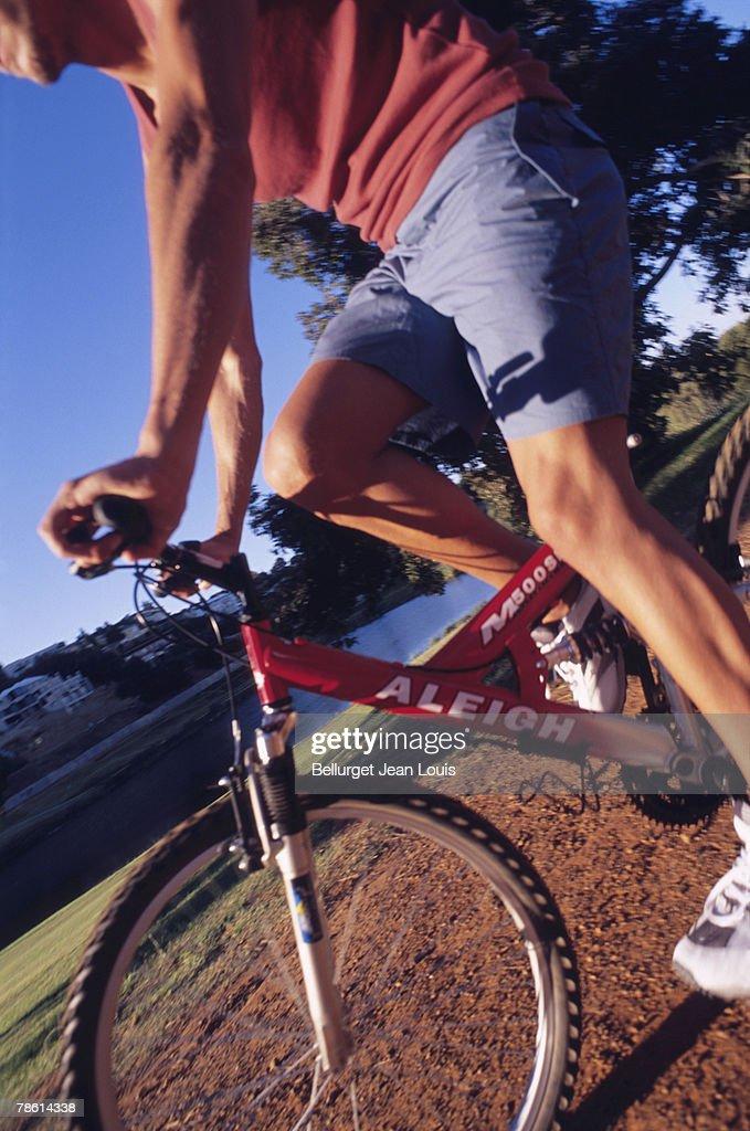 Man riding bicycle : Stock Photo