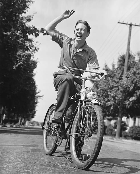 Man Riding Bicycle, Waving, (B&W) Wall Art