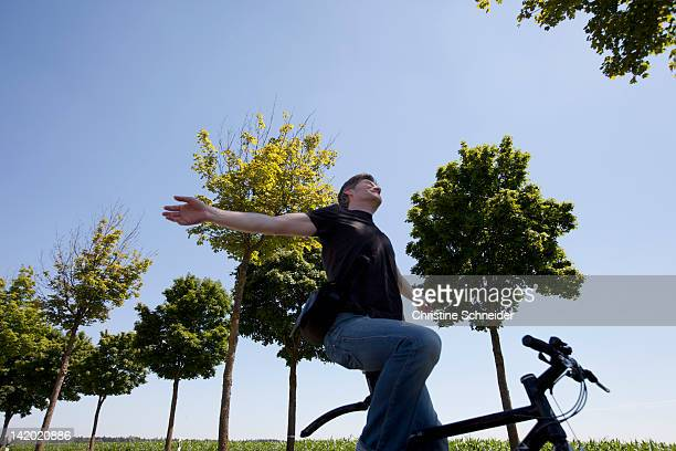 Man riding bicycle with no hands