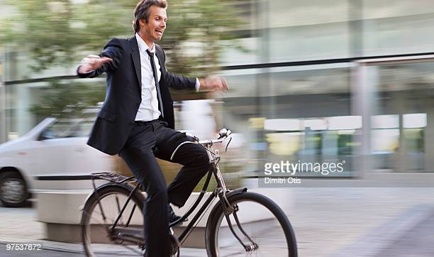 Man riding bike and letting go of the handle bars