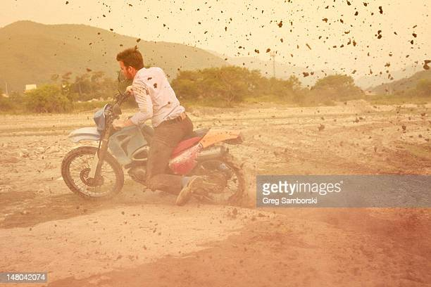Man riding bike on dirt track