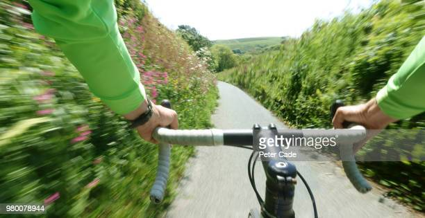 man riding bike pov - personal perspective stock pictures, royalty-free photos & images
