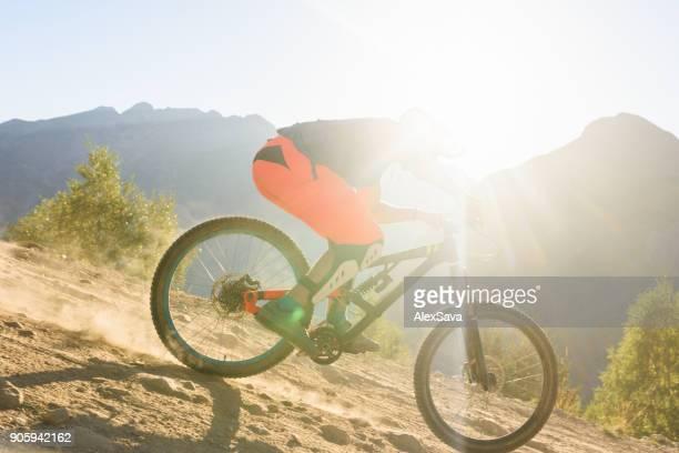 Man riding dirt bike downhill singletrack in Les Deux Alps