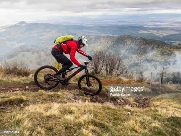 Man riding electric mountain bike on cycling tour, Vosges, France