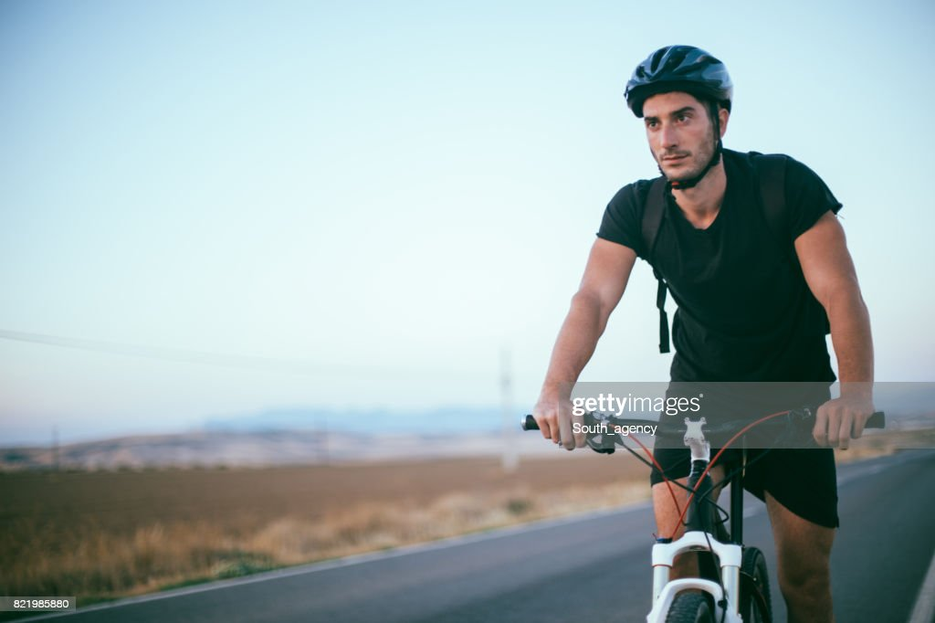 Man riding his bicycle : Stock Photo