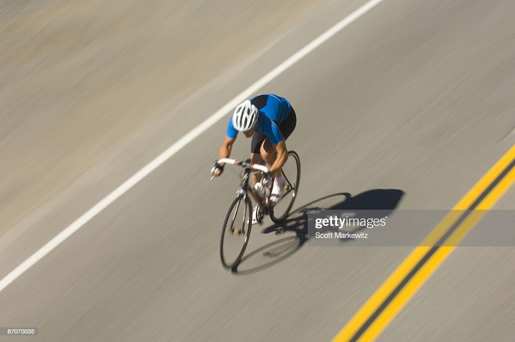 Man Riding His Road Bike On Donner Pass Road Truckee California